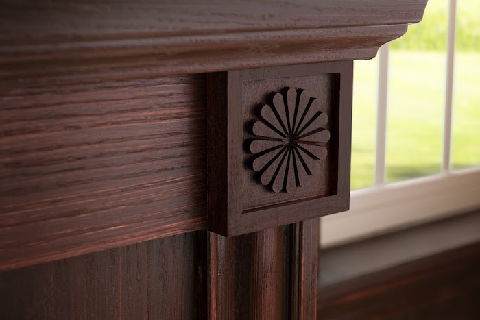 Metrie's Pretty Simple Rosettes adds flare and character to fireplace. Image Source: Metrie.