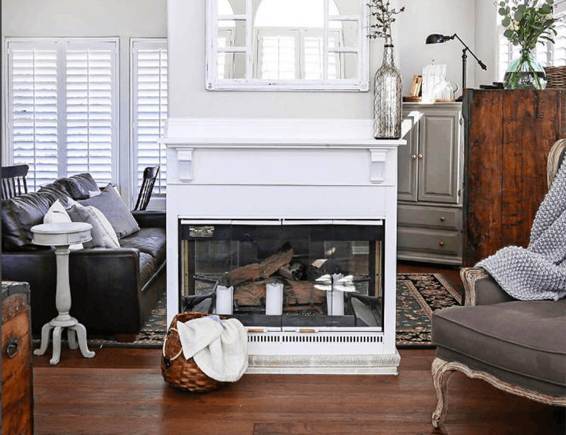 Stunning two-sided fireplace has a DIY shelving unit to maximize space, which can be made from Metrie's flat stock and half round. Image Source: Apartment Therapy.