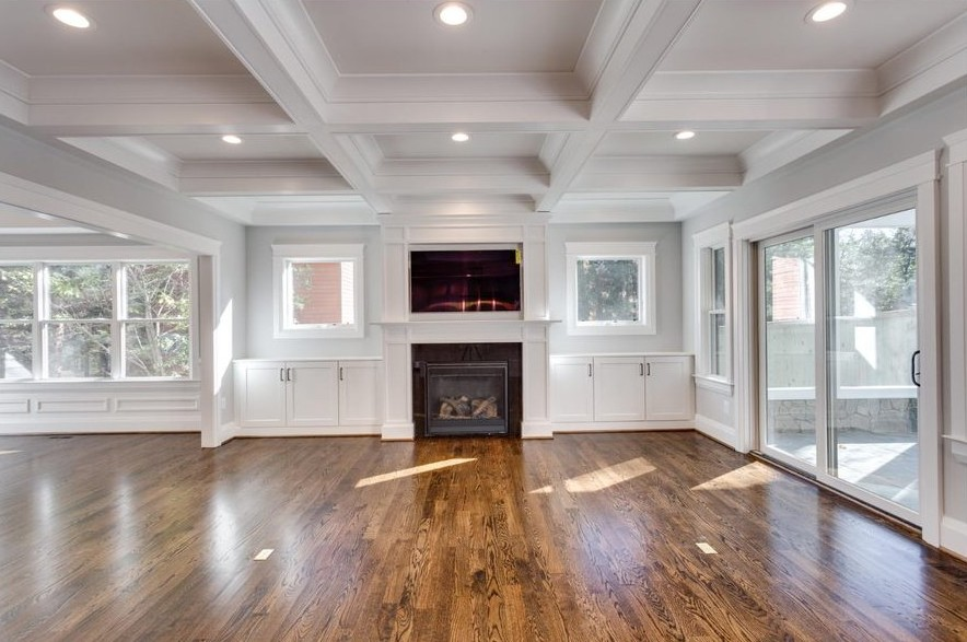 Classic Cottages showcases a gorgeous coffered ceiling inside this great room