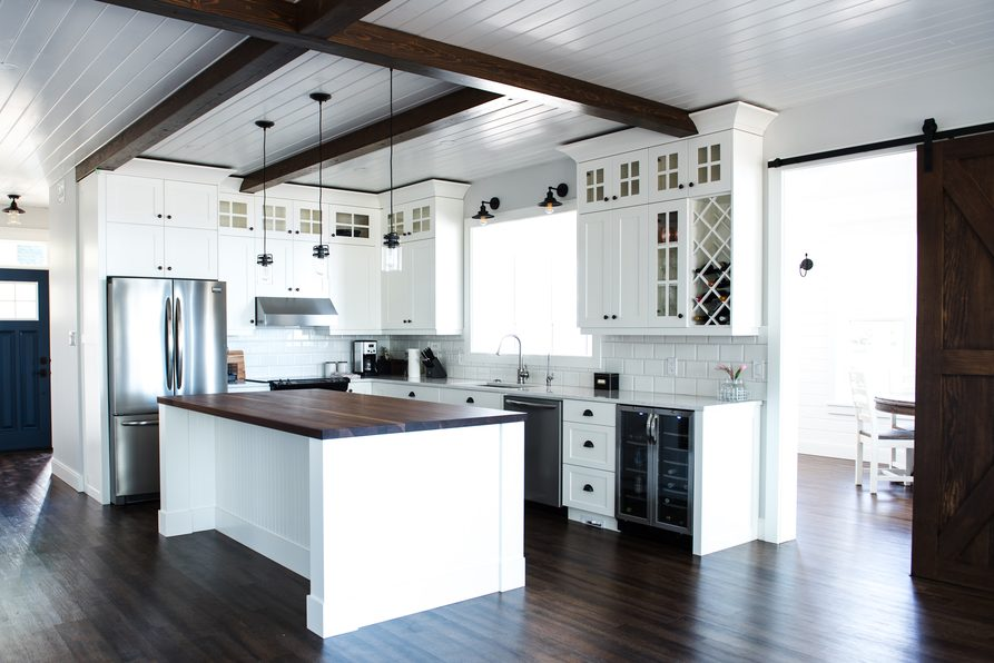 The farmhouse feel of this space is brought home with a tongue and groove ceiling