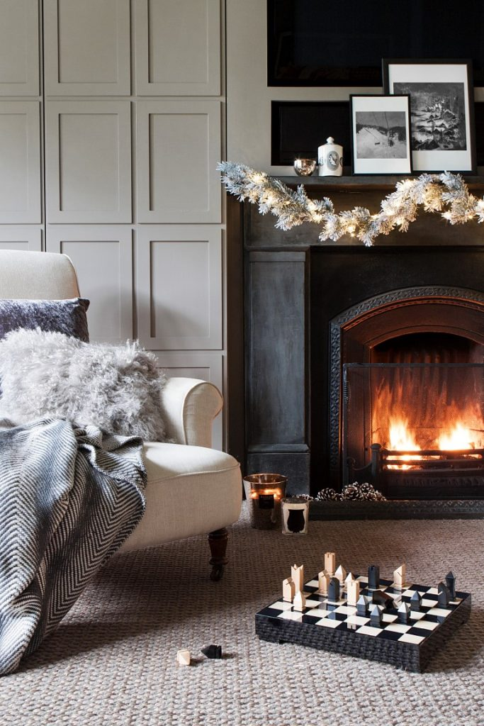 Curl up by the fireplace and embrace the hygge spirit