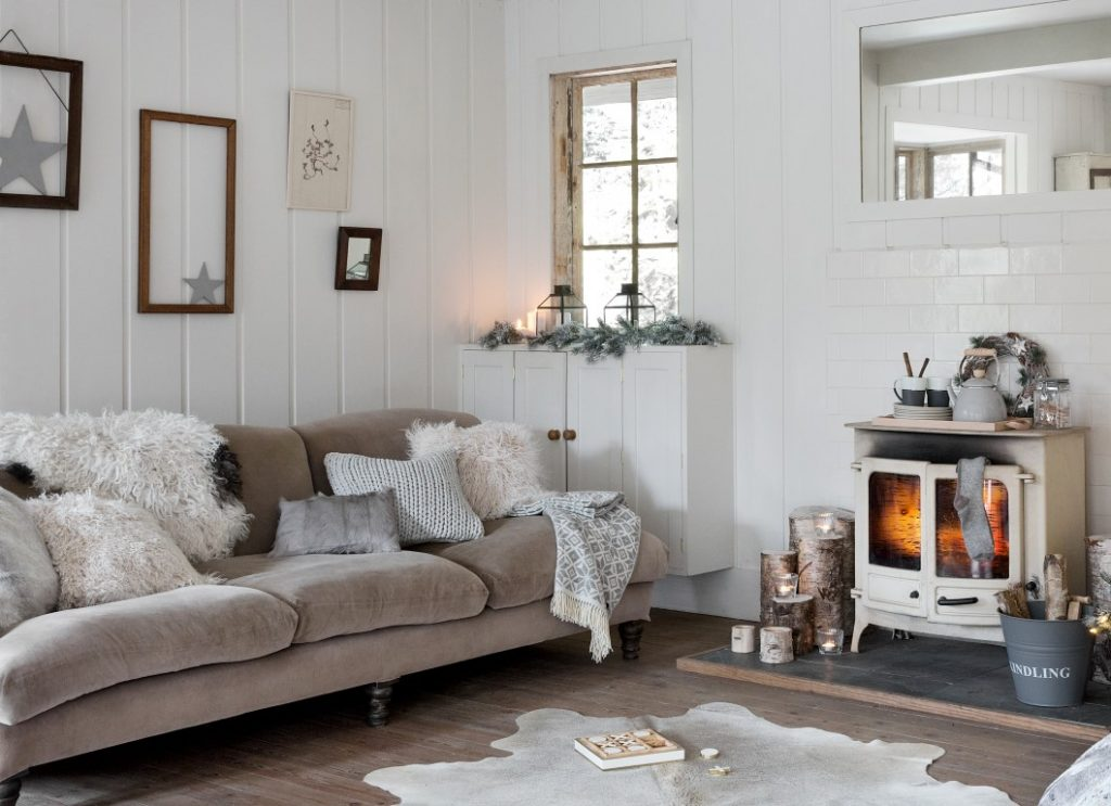 A hygge-inspired living room filled with cozy blankets and throws