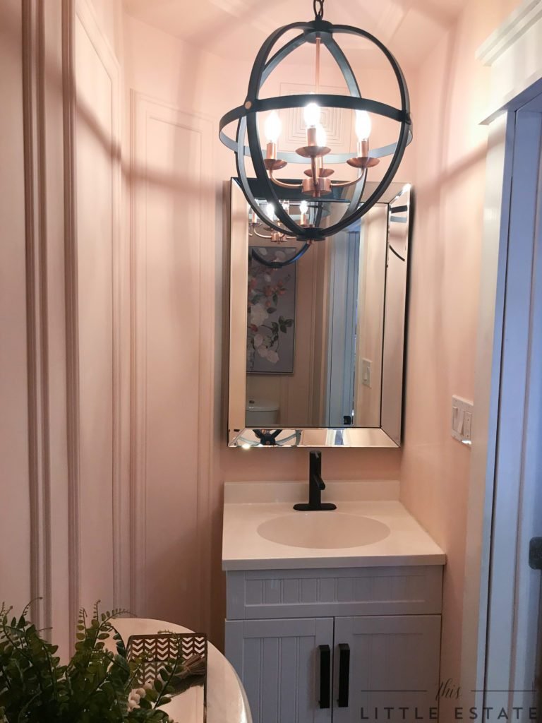 This Little Estate reveal a pretty powder room