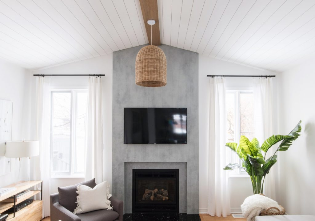 Sacha and Melissa, of Leclair Decor, tops off their space with a ceiling treatment made from Metrie Complete pre-painted shiplap.